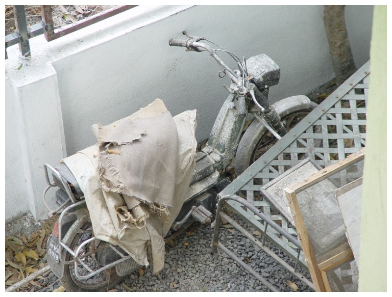 an old bike stuttering and sputtering in a forgott