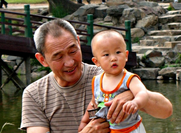 man and his boy in Chengde, China