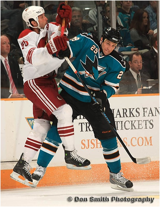 Ryane Clowe delivers a hard hit.