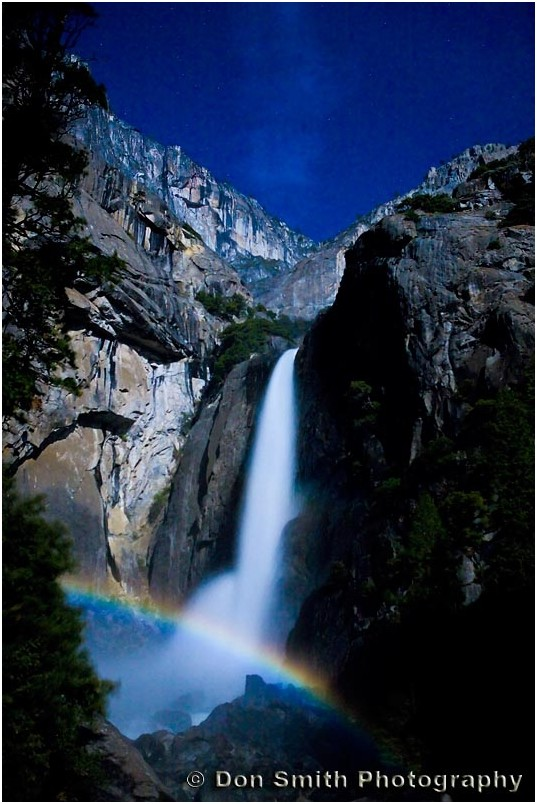 A lunar rainbow forms over base of Yosemite Falls