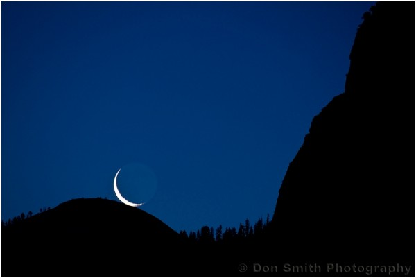 A rising crecent moon over Sentinel Dome