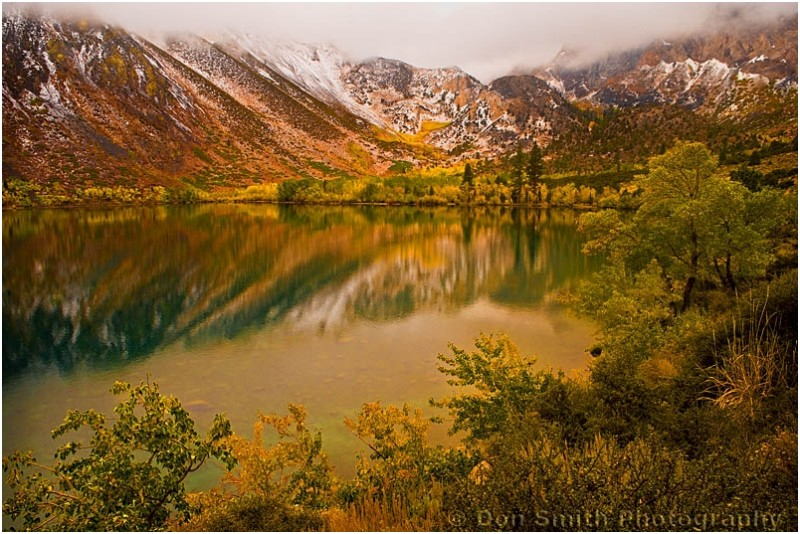 Snow and Fall color rim Convict Lake.