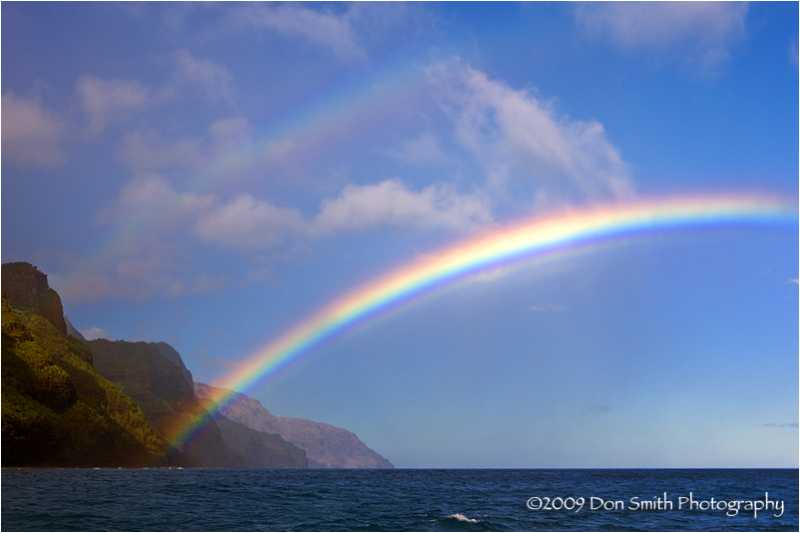 Double-rainbow along Na Pali coast, Kauai, Hawaii.
