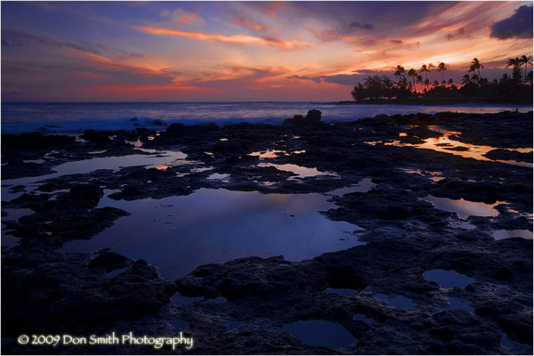 Dusk sky over lava beds at Brennecke Beach, Kauai.