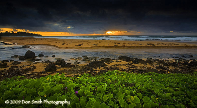 Sunrise through storm clouds near Kapaa, Kauia.