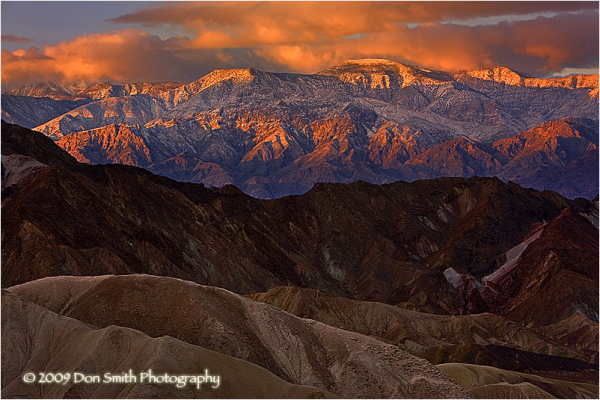 Sunrise over snow-capped Pananmints from Zabriskie