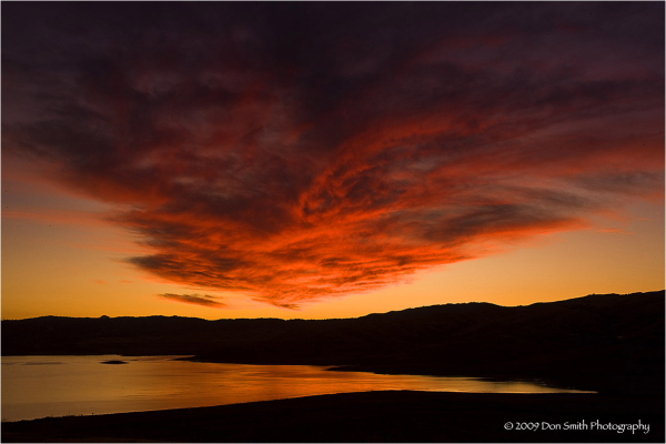Lit cloud over San Luis Reservoir.