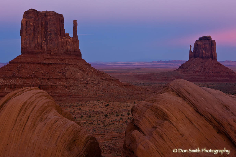 Dusk glow on the Mittens, Monument Valley.
