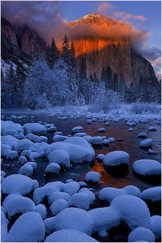 Alpenglow strikes El Capitan, Yosemite.