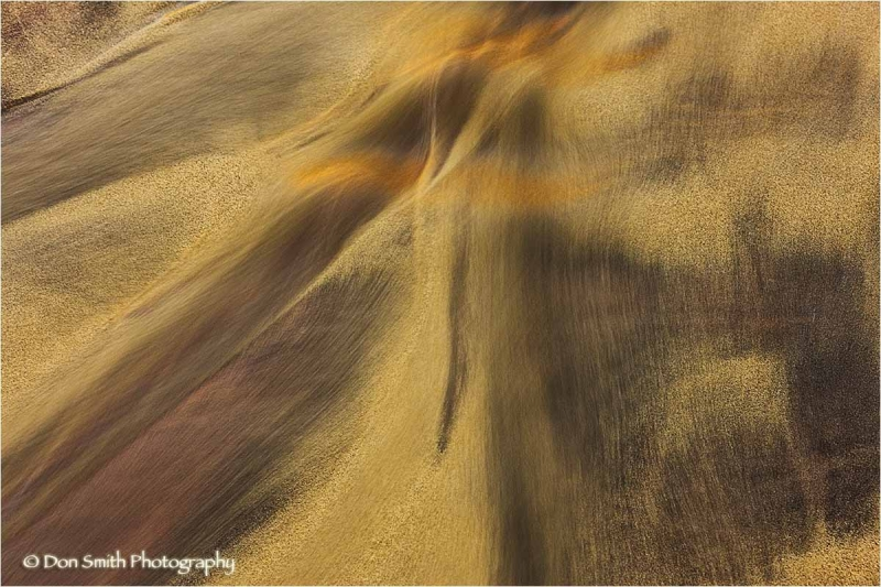 Abstract image of stream through sand.