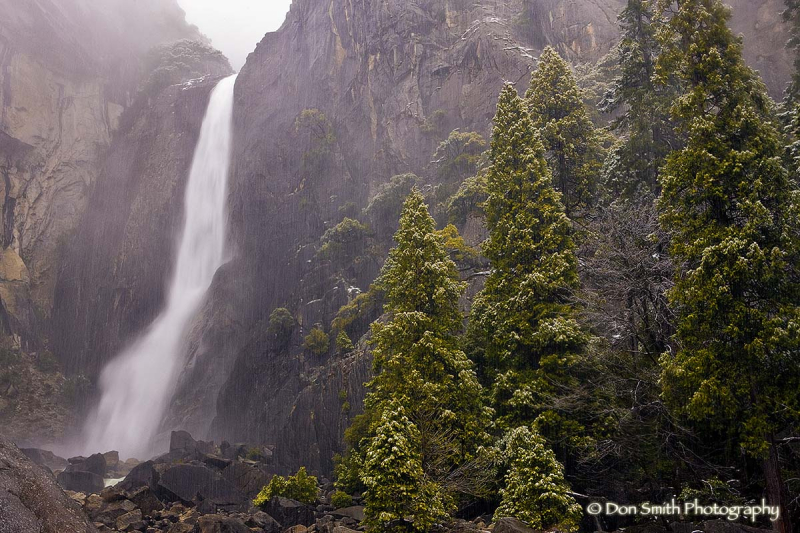 Lower Yosemite Falls and snowy spring day.