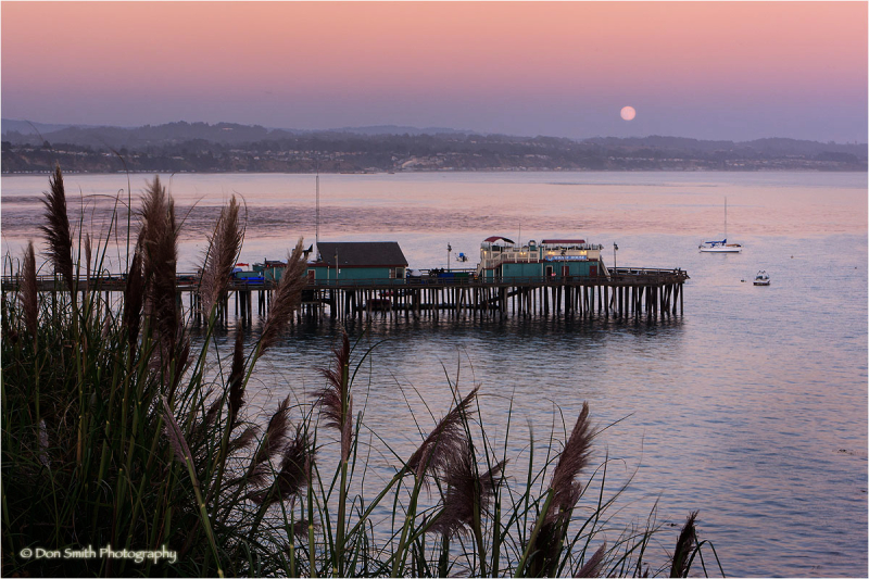 Full moonrise over Capitola Wharf, California.