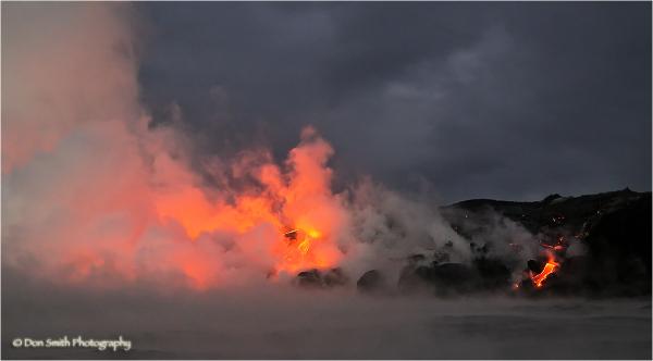 Lava from Kilauea volcano flows into ocean at dawn