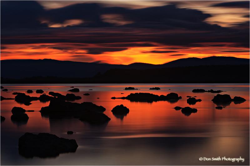 A dawn sky reflects onto surface of Mono Lake.