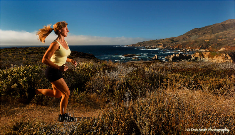 Fit woman stretches at Sobranes Pt. Big Sur.