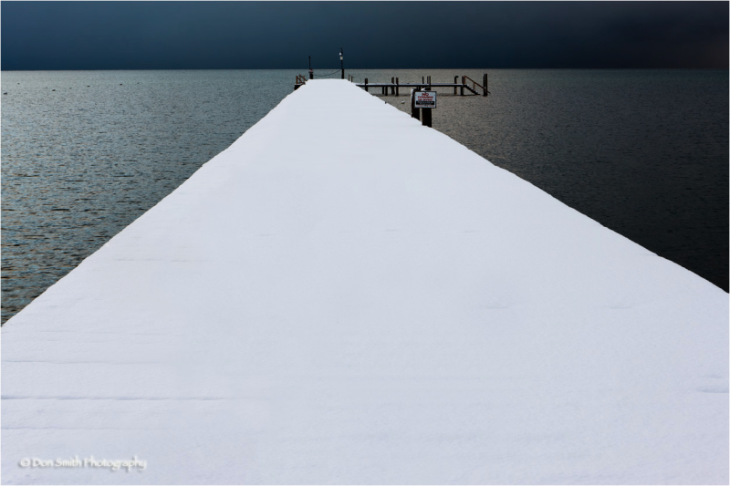 Snow-covered pier, South Lake Tahoe.