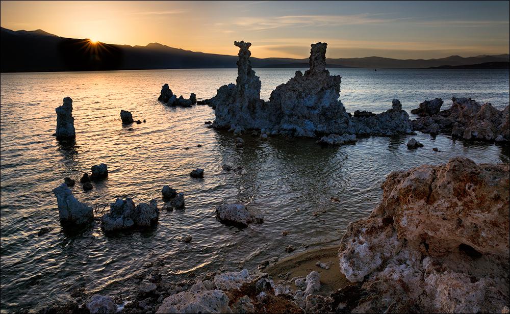 A setting sun creates a sunstar at Mono Lake.