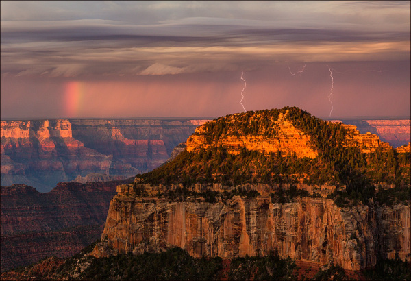 Rainbow and lightning at sunrise, Grand Canyon NP.