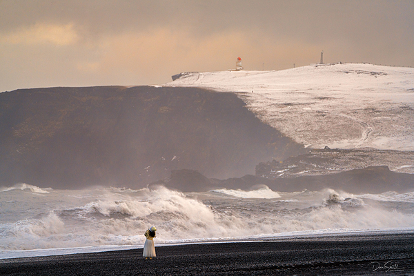 Woman in White Dress on Black Sand Beach, Iceland