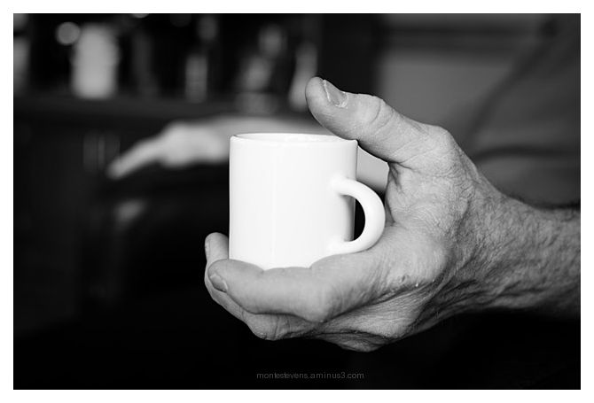 Carefully Holding His Demitasse Cup