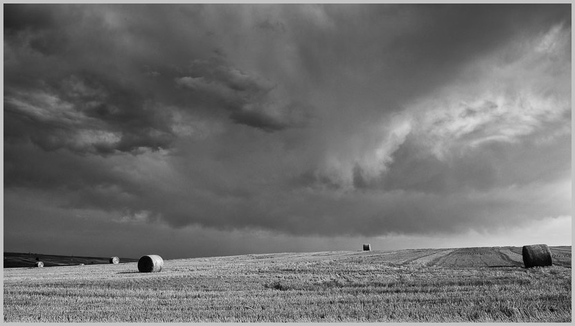 Hay Bales and Storm Clouds