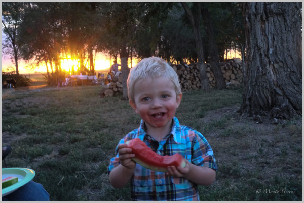 Watermelon and Dirt Make for a Happy Boy