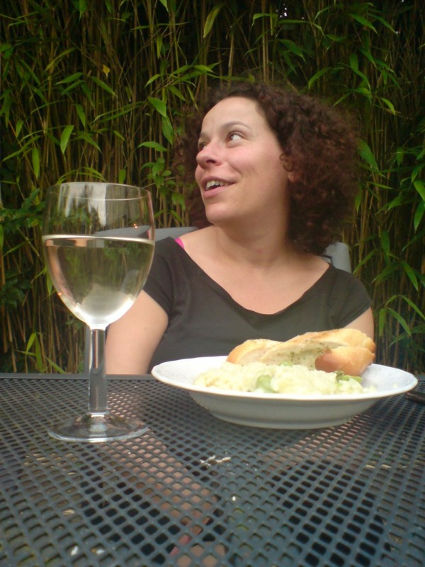 Gabi enjoying good food and wine