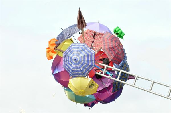 PLAYING  WITH UMBRELLAS-2