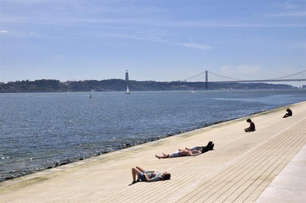 RESTING IN LISBON BY THE RIVER