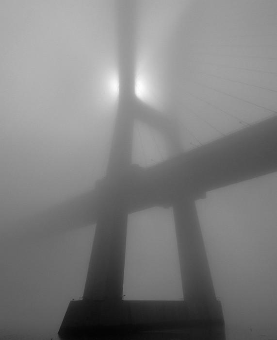 Vasco da Gama bridge under fog