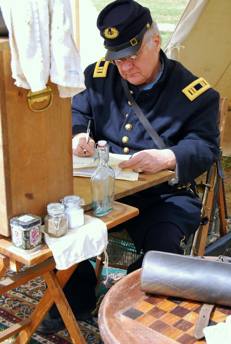 Soldier writing and reading