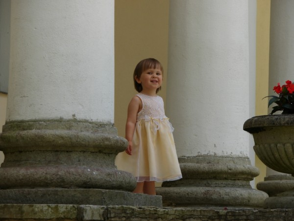 little girl staying on the stairs