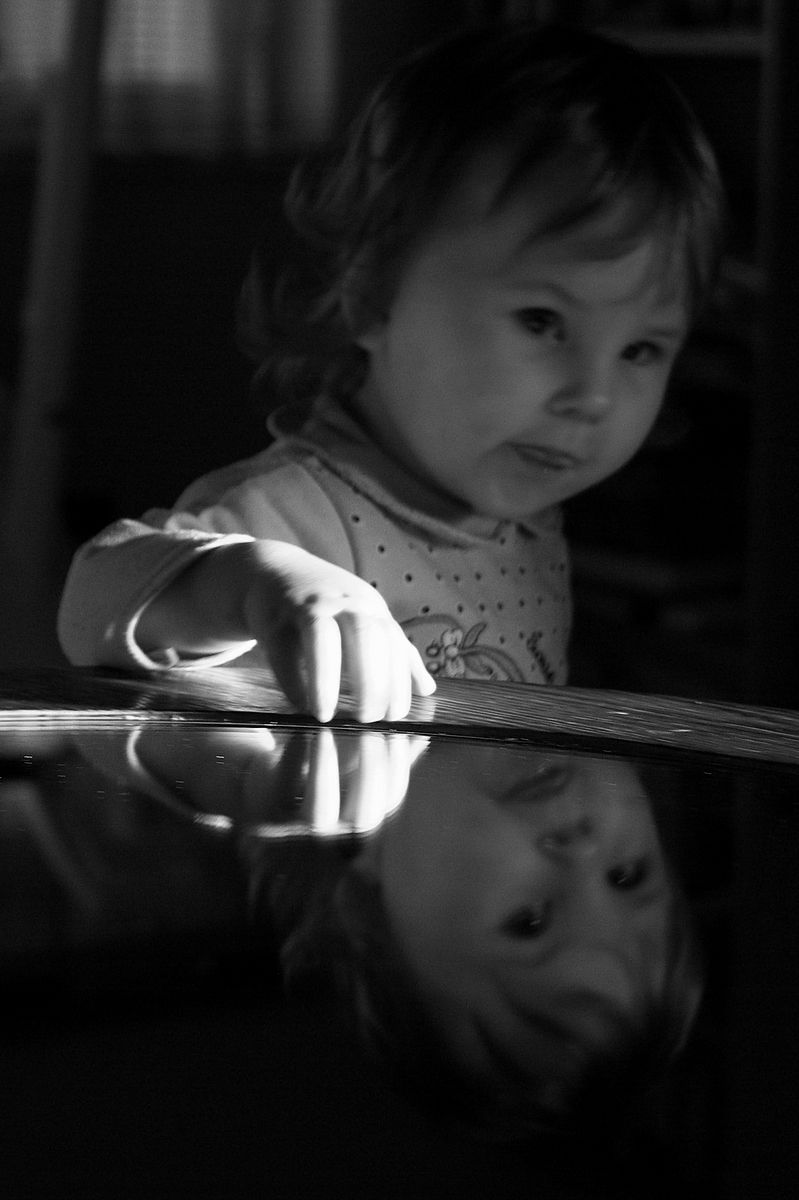 child is looking into mirror