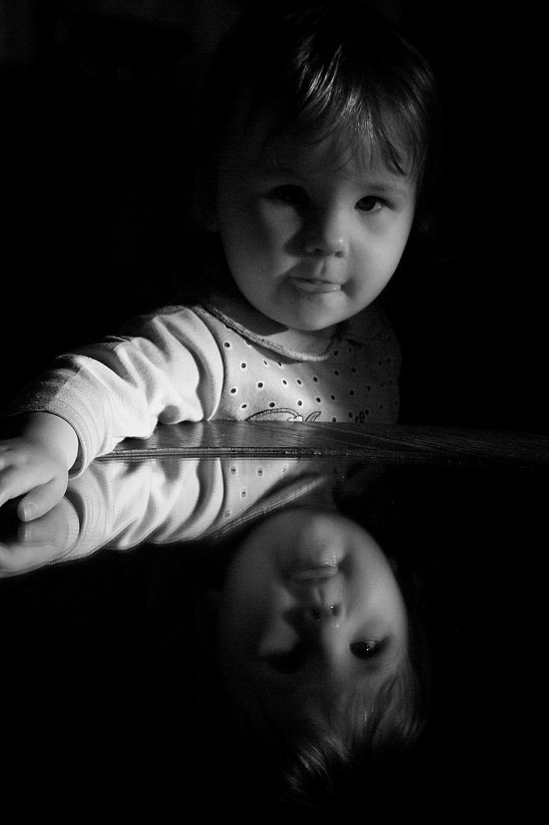 little girl's reflection in the mirror
