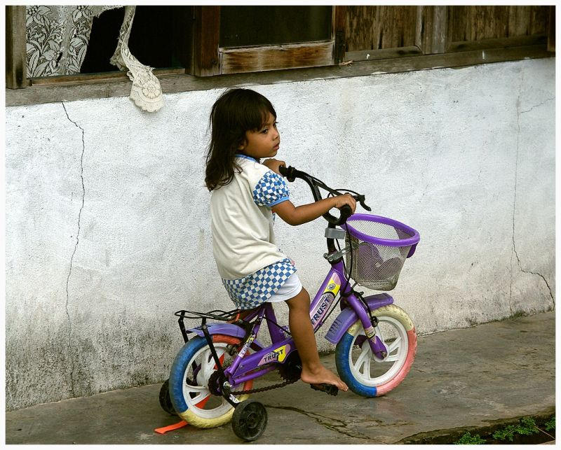 little girl driving bicycle
