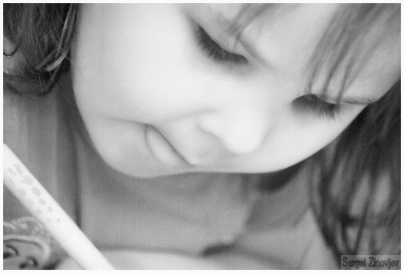little girl holding a pen