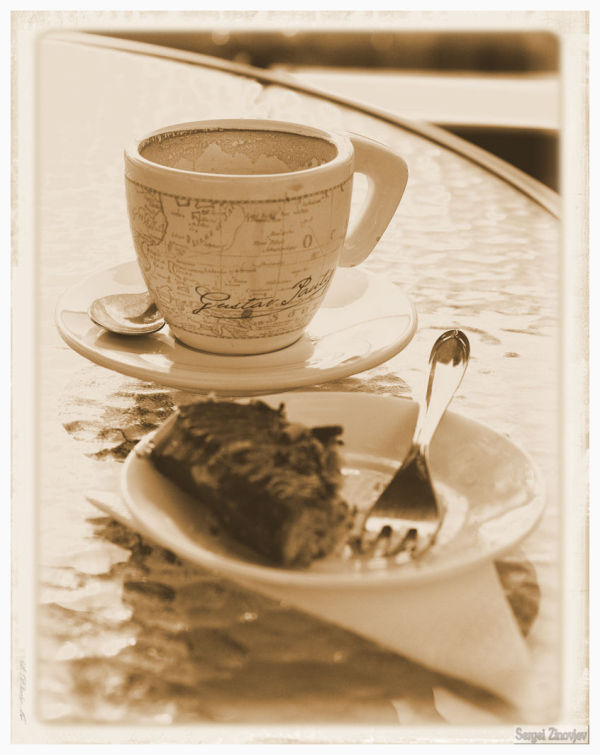 coffee cup and cake in sepia