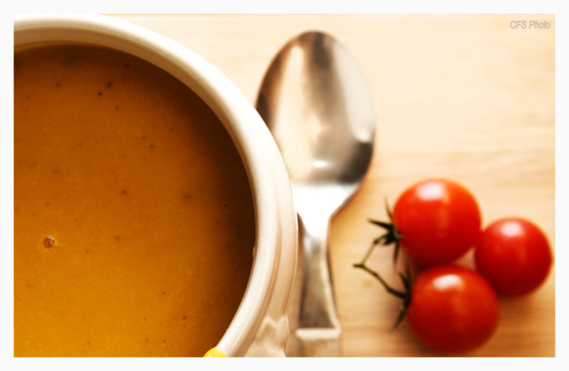 soup and red tomatoes on the table