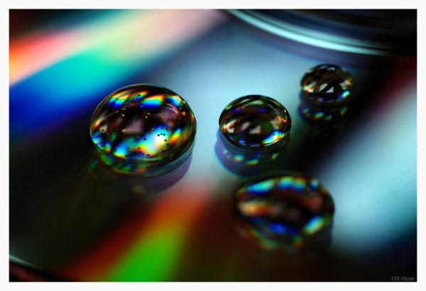 colorful drops of water on the cd