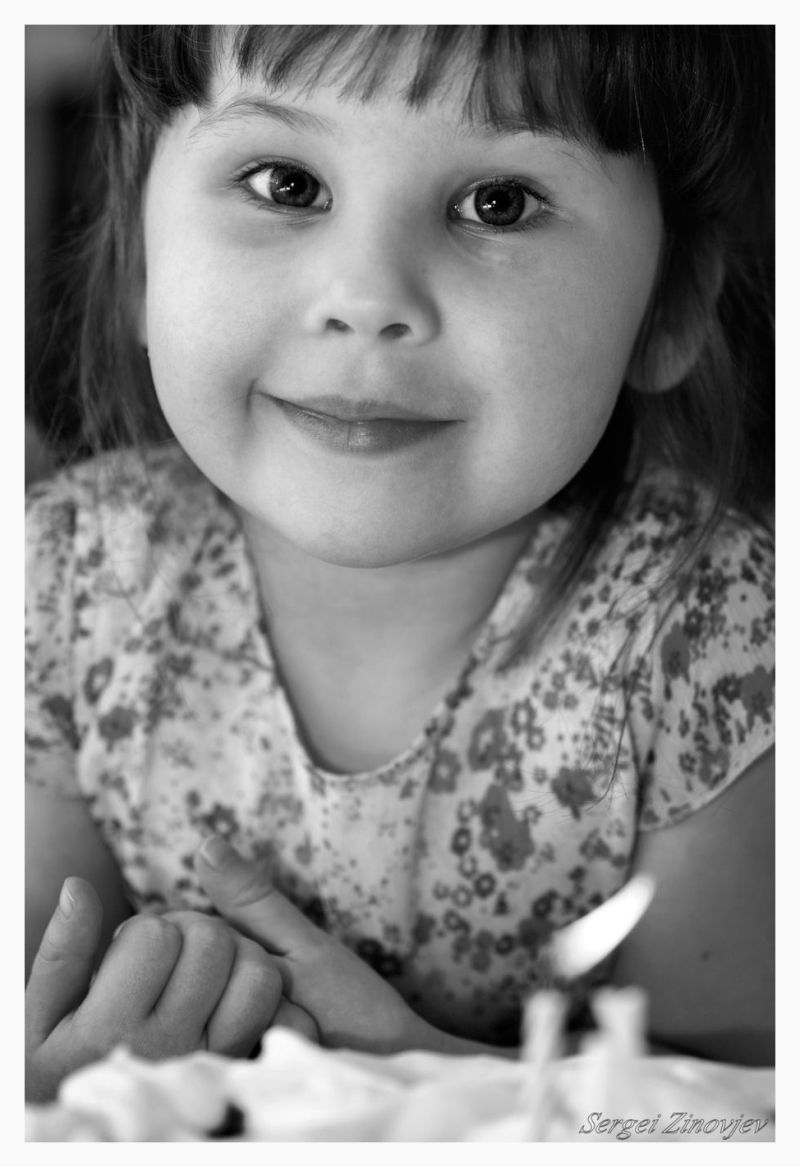 little girl is waiting for birthday cake