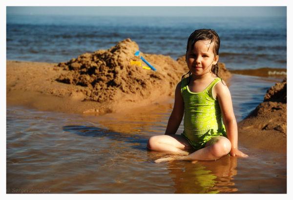 Girl in the water enjoying beautiful summer day