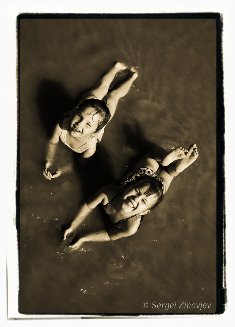 two girls playing in the water