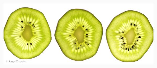 close-up of three kiwi slices