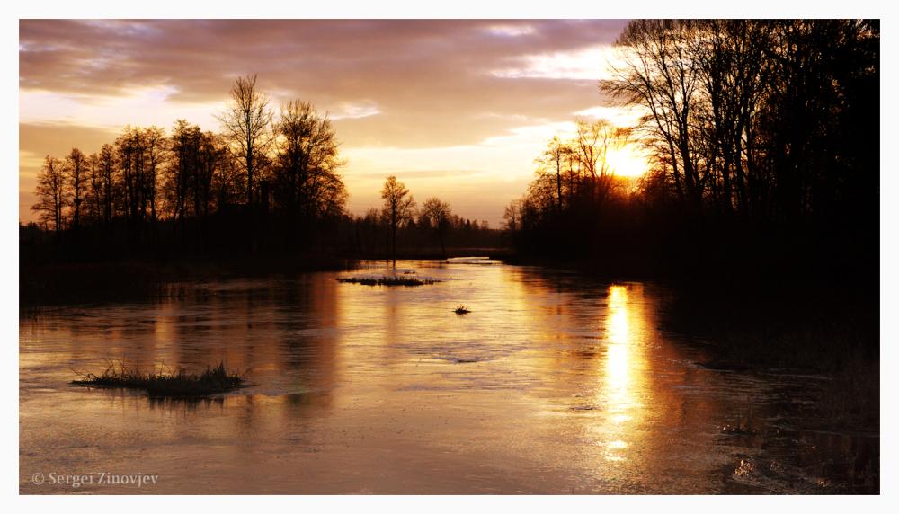 sunset and sun reflection in Prandi river, Estonia