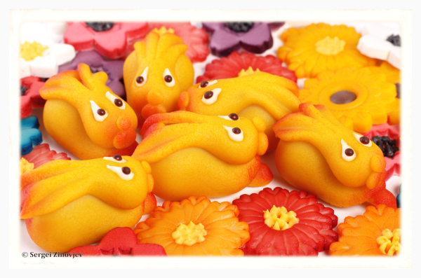 marzipan rabbits in the middle of marzipan flowers