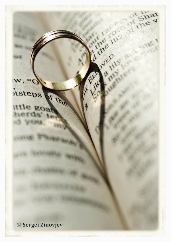heart shadow on the book from the wedding ring