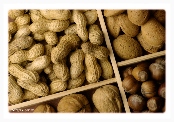 different nuts in the wooden box