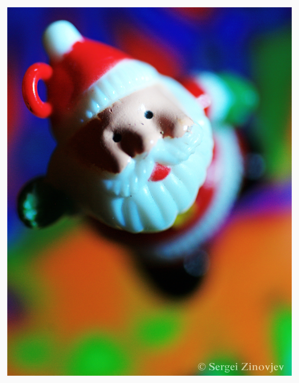 Santa Claus toy on colorful background
