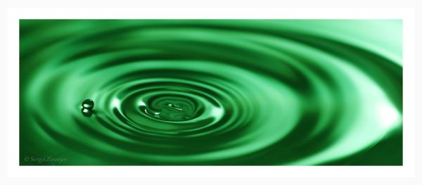 macro shot of water drop in green color