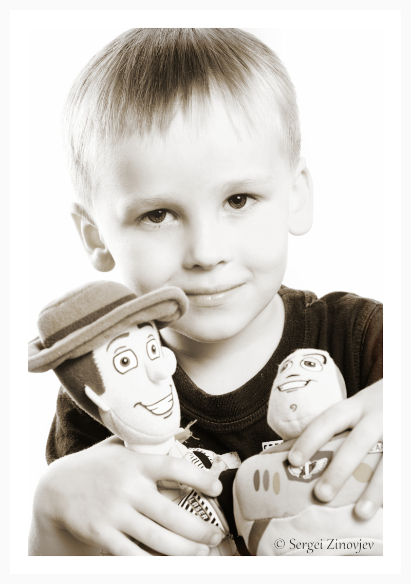portrait of boy with toys